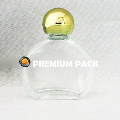 Oblong watch glass bottle with shiny golden ball cap
