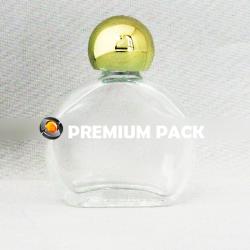 Oblong watch glass bottle with shiny golden ball cap