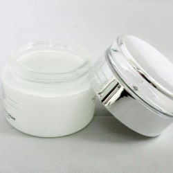 White glass jar featuring acrylic shiny silver cap