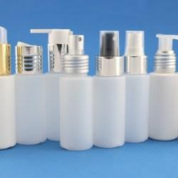 Metallic dispensing closures for enhanced, eye-catching shelf appeal