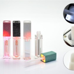 LED lite-up lipgloss with glittery over spray decoration