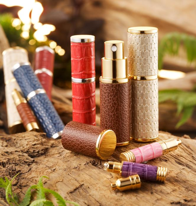 Magnetics leather wrapping adds a touch of glamour to perfume atomizers